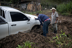"""A vehicle of COCASJOL coffee coop got stuck in the mud on a routine visit to a farm. Access to farms has become increasingly difficult with many major and minor roads unpassable. Victor Manuel Pineda Granados (right) is a coffee farmer and is a member of the COCASJOL cooperative. """"I have 4.5 manzanas, I've been affected by the landslides and quite a few trees that have fallen down, three of my big trees went down. With hurricane Mitch I was badly affected, in the same places, but I planted over the top again, but we aren't so good economically now, so I don't know, we'll see if we can recover from this somehow."""""""