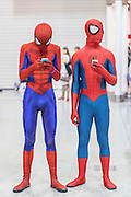 UNITED KINGDOM, London: Cosplay fans dressed as Spider-Man stand lost at the MCM London Comic Con at the ExCel Arena in east London. The three day event, which finishes today is said to have brought 130,000 comic con fans and cosplay enthusiasts. Rick Findler / Story Picture Agency