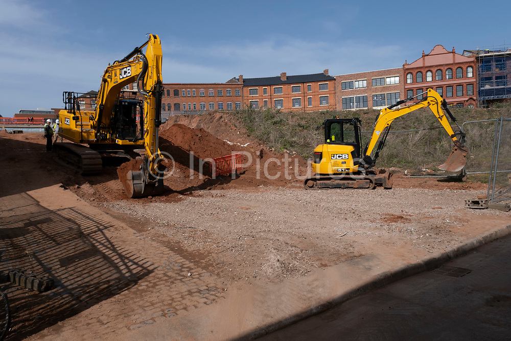 Construction site in the Jewellery Quarter on 30th March 2021 in Birmingham, United Kingdom. There are several major redevelopment works currently in this old and prestigious area near the city centre, with much of the old jewellers gone and being replaced by offices or residential homes.