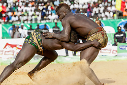 DAKAR, April 6, 2015  Wrestlers compete in the Senegalese traditional wrestling match ''Le Choc'' at Demba Diop Stadium, Dakar, capital of Senegal, April 5, 2015. Thousands of audience have watched the biggest match here on Sunday at the beginning of the wrestling season with the most famous wrestlers Balla Gaye 2 and Eumeu Sene competing. Eumeu Sene won the match at last.  (Credit Image: RealTime Images)