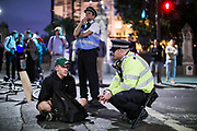 London MET Police seen negotiating with an anti-Brexit protestor in attempt to disperse them from the main Parliament Square in late before mid-night in front of the Houses of Parliament in central London, Wednesday, Aug. 28, 2019. <br /> British Prime Minister Boris Johnson maneuvered on Wednesday to give his political opponents even less time to block a no-deal Brexit before the Oct. 31 withdrawal deadline, winning Queen Elizabeth II's approval to suspend Parliament. (Photo/Vudi Xhymshiti)