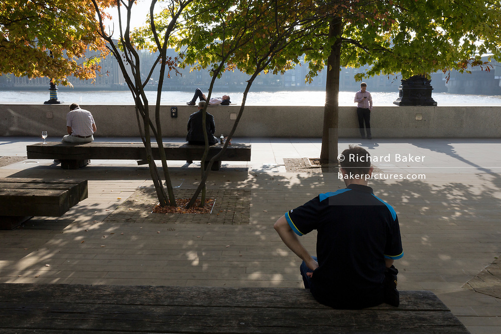 Office workers in the City of London - the capital's financial district - enjoy late summer temperatures on Hanseatic Walk, on 10th October 2018, in London, England.
