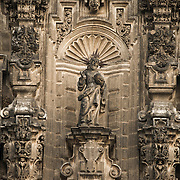 The ornate eastern facade of the Metropolitan Tabernacle has depictions of Old Testament scenes. Adjacent to the Metropolitan Catheral, facing the Zocalo, the Metropolitan Tabernacle (Spanish: Sagrario Metropolitana) was built by Lorenzo Rodríguez in the Baroque style between 1749 and 1760. It was designed to to house the archives and vestments of the archbishop. It also functioned and continues to function as a place to receive Eucharist and register parishioners.