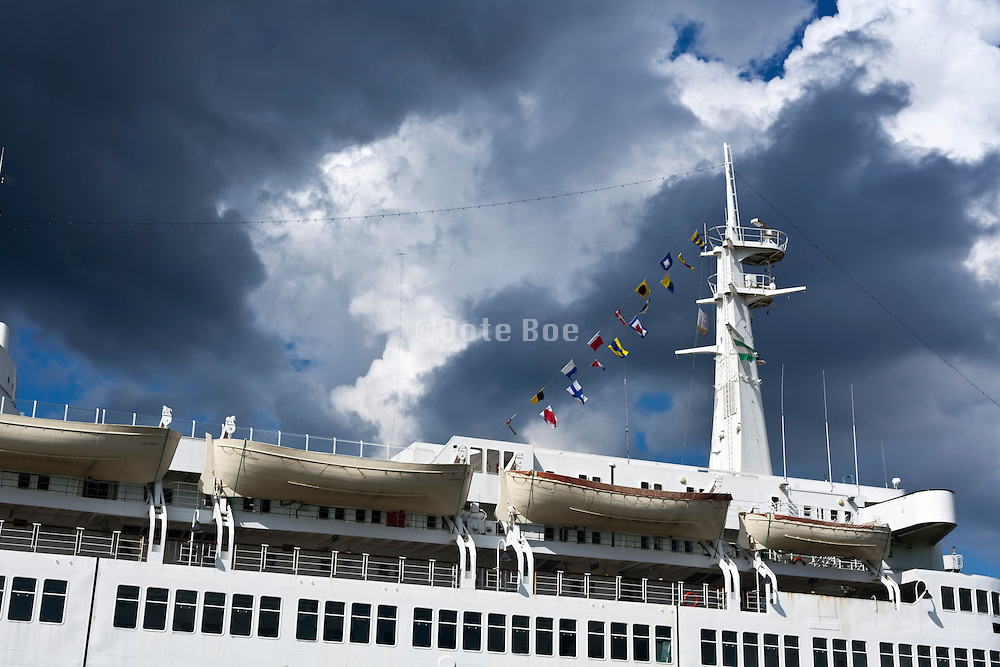 mast and upper deck of the The SS Rotterdam former flagship of the Holland-America line, now permanently moored as a hotel and museum
