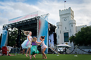 Izzy Leland, 7, Hannah Leland, 3, and Monroe Creech, 5 dance together before a performance from the American Ballet Theater on Summerall Field in Charleston, South Carolina on Saturday, July 17, 2021. <br /> <br /> Credit: Cameron Pollack / The Citadel