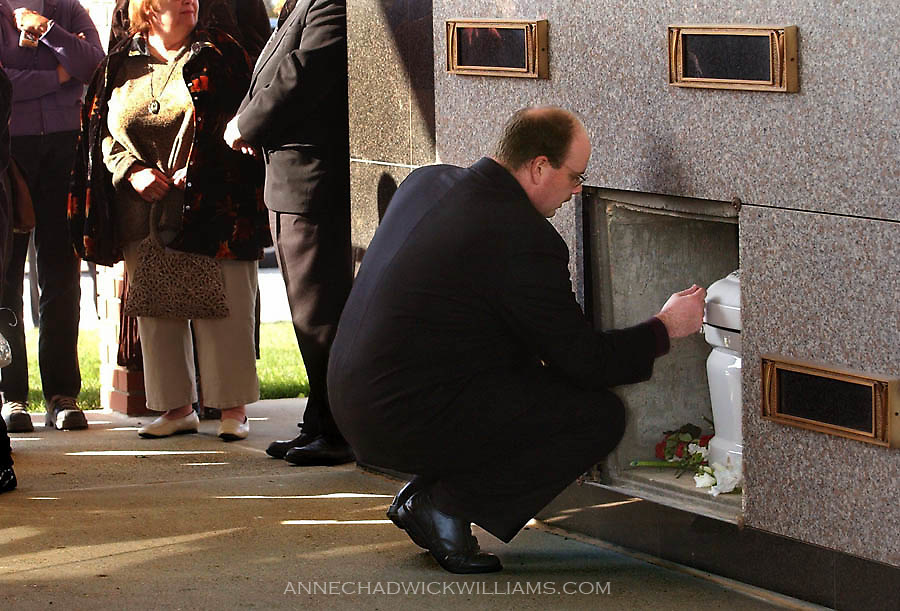 John Bennett says goodbye to his son, Tommy, 4, at the mausoleum at Sunset View Cemetery in Jackson, CA Tuesday. Tommy died at Duke University Medical Center in Durham, North Carolina while undergoing a year of treatment for Sanfilippo syndrome, a rare genetic disease.  His siblings also share the fatal disease. December 2, 2003..