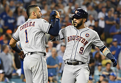 October 25, 2017 - Los Angeles, California, U.S. - Houston Astros' Marwin Gonzalez (9) celebrates with teammate Carlos Correa (1) after hitting a solo home run to tie the game against the Los Angeles Dodgers in the ninth inning of game two of a World Series baseball game at Dodger Stadium on Wednesday, Oct. 25, 2017 in Los Angeles. Houston Astros won 7-6 in 11 innings. (Photo by Keith Birmingham, Pasadena Star-News/SCNG) (Credit Image: © San Gabriel Valley Tribune via ZUMA Wire)
