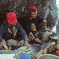 A Sherpa crew cooks lunch for a group of trekkers en route to Mount Everest Base Camp.
