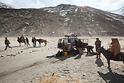 A broken wheel and axe. Between Khandud and Ishkashim..Driving down from Sarhad village, end of the road in the Wakhan corridor, to Ishkashim town, on the Tajikistan border.