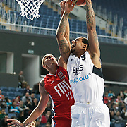 Efes Pilsen's Lawrence ROBERTS (R) and Tofas's Ilkan KARAMAN (L) during their Turkish Basketball league match Efes Pilsen between Tofas at the Sinan Erdem Arena in Istanbul Turkey on Sunday 27 February 2011. Photo by TURKPIX