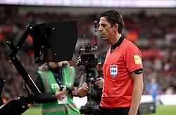 Referee Deniz Aytekin reviews the VAR