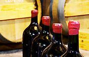 Bottle neck with red wax seal. Domaine des Grecaux in St Jean de Fos. Montpeyroux. Languedoc. Barrel cellar. Bottle cellar. France. Europe. Bottle.