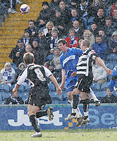 Photo: Matt Bright/Richard Lane Photography. <br />Stockport County v Darlington. Coca Cola Divison Two. 05/04/2008. Anthony Pilkington (C) clears fromTommy Wright (L) in the sleet