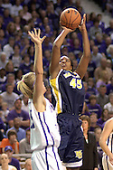 Marquette forward Marissa Thrower (45) scores over Kansas State's Danielle Zanotti (L), during the first half of the WNIT Finals at Bramlage Coliseum in Manhattan, Kansas, March 31, 2006.  Marquette leads K-State 39-38 at halftime.