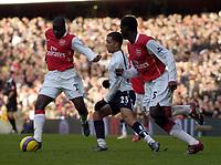 Photo: Olly Greenwood.<br />Arsenal v Tottenham Hotspur. The Barclays Premiership. 02/12/2006. Arsenal's Emmanuel Eboue and Kolo Toure get the better of Tottenham's Aaron Lennon