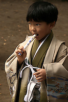 Japanese boy at Shichi-Go-San, literally seven-five-three, a traditional rite of passage in Japan held annually on November 15.  The event is not a national holiday, so it is often observed on the nearest weekend and these days througout November.  Boys who are aged three or five and girls who are aged three or seven are dressed in kimono, usually for the first time, for visits to shrines.