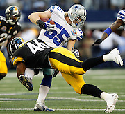 Dallas Cowboys outside linebacker Alex Albright (55) is tackled by Pittsburgh Steelers fullback Will Johnson (46) at Cowboys Stadium in Arlington, Texas, on December 16, 2012.  (Stan Olszewski/The Dallas Morning News)