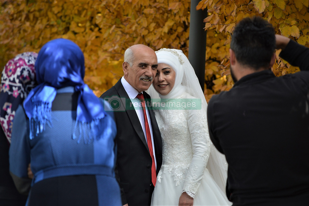 November 18, 2018 - Ankara, Turkey - A newly-wed couple pose for a photo in Ankara, Turkey on November 18, 2018. Reports suggest that winter weddings in Turkey are increasing recently due to economic difficulties as holding wedding ceremonies in winter are slightly cheaper than in summer. (Credit Image: © Altan Gocher/NurPhoto via ZUMA Press)