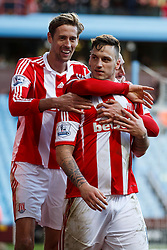 Stoke Forward Marko Arnautovic (AUT) is hugged by goalscorer Geoff Cameron (USA) and Forward Peter Crouch (ENG) after going over to the Aston Villa fans - Photo mandatory by-line: Rogan Thomson/JMP - 07966 386802 - 23/03/2014 - SPORT - FOOTBALL - Villa Park, Birmingham - Aston Villa v Stoke City - Barclays Premier League.