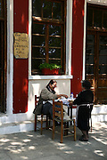 Greece, Pelion, Argalasti Two woman at an outdoor cafe