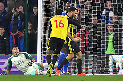 Watford's Abdoulaye Doucoure (centre) celebrates scoring his side's first goal of the game with team-mate Troy Deeney during the Premier League match at the Cardiff City Stadium.