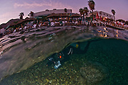 Israel, Eilat, Red Sea, - Underwater photograph of an underwater photographer preparing for a dive