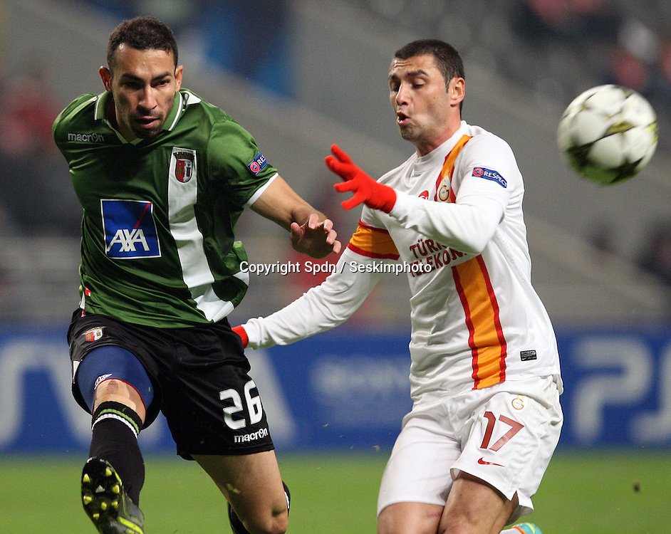 UEFA Champions league group H football match between  Braga v Galatasaray at Municipal (AXA)Stadium in Braga, Portugal 05.12.2012.Match Scored: Braga 1 - Galatasaray 2.Pictured: Paulo Vinicius of Braga and Burak Yilmaz of Galatasaray.