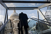 A view of St Paul's Cathedral, seen through the entrance of a shopping mall opposite in the City of London. St Paul's Cathedral, London, is a Church of England cathedral and seat of the Bishop of London. Its dedication to Paul the Apostle dates back to the original church on this site, founded in AD 604. St Paul's sits at the top of Ludgate Hill, the highest point in the City of London, and is the mother church of the Diocese of London. The present church dating from the late 17th century was built to an English Baroque design of Sir Christopher Wren, as part of a major rebuilding program that took place in the city after the Great Fire of London, and was completed within his lifetime.