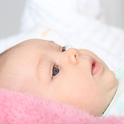 A two month old baby girl baby observing her surroundings. Photo Tim Clayton