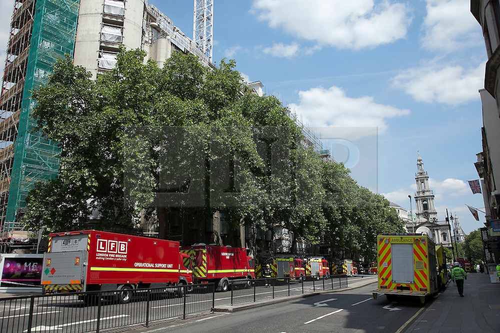 © Licensed to London News Pictures. LONDON, UK  14/06/11. Fire engines line Aldwich as 75 fire fighters tackle a blaze that broke out in luxury apartments undergoing renovation in London today (Tuesday). Please see special instructions for usage rates. Photo credit should read Matt Cetti-Roberts/LNP
