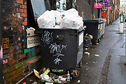 Rubbish overflowing from a commercial bin in the area of Digbeth  in central Birmingham, United Kingdom.  Following the destruction of the Inner Ring Road, Digbeth is now considered a district within Birmingham City Centre. As part of the Big City Plan, Digbeth is undergoing a large redevelopment scheme that will regenerate the old industrial buildings into apartments, retail premises, offices and arts facilities. There is still however much industrial activity in the south of the area.