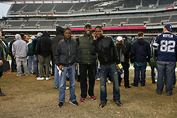 Guests pose for a picture on the sideline before the NFL Game between the Dallas Cowboys and the Philadelphia Eagles.  The Cowboys Won 14-13 at Lincoln Financial Field in Philadelphia, Philadelphia on Sunday January 2nd 2010. (AP Photo/Brian Garfinkel)