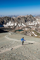 Female hiker descending from Handies peak (14053 ft), San Juan mountains, Colorado, USA