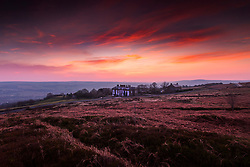 © Licensed to London News Pictures. 25/03/2020. Ilkley UK. The sky glows red over the Cow & Calf pub high up on Ilkley Moor in Yorkshire at Dawn this morning on the second day of the Coronavirus lockdown. Photo credit: Andrew McCaren/LNP
