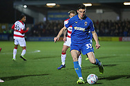 AFC Wimbledon midfielder Callum Reilly (33) dribbling and about to pass the ball during the EFL Sky Bet League 1 match between AFC Wimbledon and Doncaster Rovers at the Cherry Red Records Stadium, Kingston, England on 14 December 2019.
