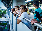 06 DECEMBER 2018 - SAMUT PRAKAN, THAILAND:  Women who rode the new BTS Skytrain extension to the end of the line look out from upper deck of the Kheha station, the last station on the line. The 12.6 kilometer (7.8 miles) east extension of the Sukhumvit Line of the Bangkok BTS Skytrain goes into Samut Prakan, a town east of Bangkok.  The system is now 51 kilometers long (32 miles), including the 12.6 kilometer extension that opened December 06. About 900,000 people per day use the BTS.    PHOTO BY JACK KURTZ