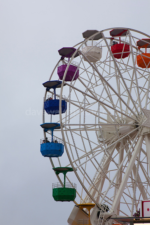 """Clouds envelope the amusement park ferris wheel at Tibidabo, Barcelona. This mage can be licensed via Millennium Images. Contact me for more details, or email mail@milim.com For prints, contact me, or click """"add to cart"""" to some standard print options."""
