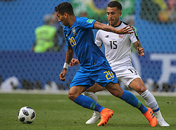 June 22, 2018 - Saint Petersburg, Russia - Roberto Firmino (L) of the Brazil national football team and Francisco Calvo of the Costa Rica national football team vie for the ball during the 2018 FIFA World Cup match, first stage - Group E between Brazil and Costa Rica at Saint Petersburg Stadium on June 22, 2018 in St. Petersburg, Russia. (Credit Image: © Igor Russak/NurPhoto via ZUMA Press)
