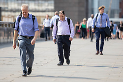 July 26, 2018 - London, UK. Commuters walk over London Bridge on what is predicted to be the hottest day of the year. Temperatures in the capital are set to rise up to 35 degrees, as the UK experiences a prolonged heatwave. (Credit Image: © Tom Nicholson/London News Pictures via ZUMA Wire)
