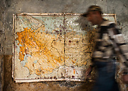 An old map showing former Russia on the wall of a run down sanatorium.<br /> In the Wakhan Corridor, Tajikistan side, in the Pamir mountains. Afghanistan is on the other side of the Panj river.<br /> <br /> Tajikistan, a mountainous landlocked country in Central Asia. Afghanistan borders it to the south, Uzbekistan to the west, Kyrgyzstan to the north, and People's Republic of China to the east. Tajikistan also lies adjacent to Pakistan separated by the narrow Wakhan Corridor.<br /> Tajikistan became a republic of the Soviet Union in the 20th century, known as the Tajik Soviet Socialist Republic.<br /> It was the first of the Central Asian republic to gain independence in December 1991.