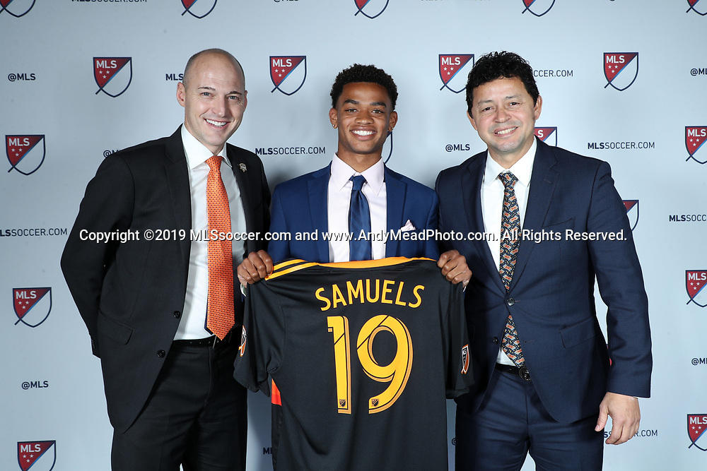 CHICAGO, IL - JANUARY 11: Andrew Samuels was taken with the 33rd overall pick by the Houston Dynamo. With general manager Matt Jordan (left) and head coach Wilmer Cabrera (right). The MLS SuperDraft 2019 presented by adidas was held on January 11, 2019 at McCormick Place in Chicago, IL.
