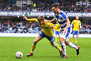 Leeds United Midfielder Jack Clarke (47) and Queens Park Rangers Defender Grant Hall (4) battle for the ball during the The FA Cup match between Queens Park Rangers and Leeds United at the Loftus Road Stadium, London, England on 6 January 2019.