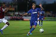 AFC Wimbledon midfielder Mitchell (Mitch) Pinnock (11) battles for possession during the EFL Carabao Cup 2nd round match between AFC Wimbledon and West Ham United at the Cherry Red Records Stadium, Kingston, England on 28 August 2018.