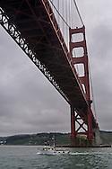 Boat passing under the Golden Gate Bridge, San Francisco Bay, California