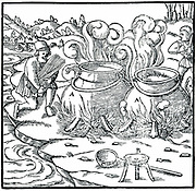 Evaporating sea water in iron pots to obtain salt. Straw being used as fuel.  From Agricola 'De re metallica', Basel, 1556. Woodcut