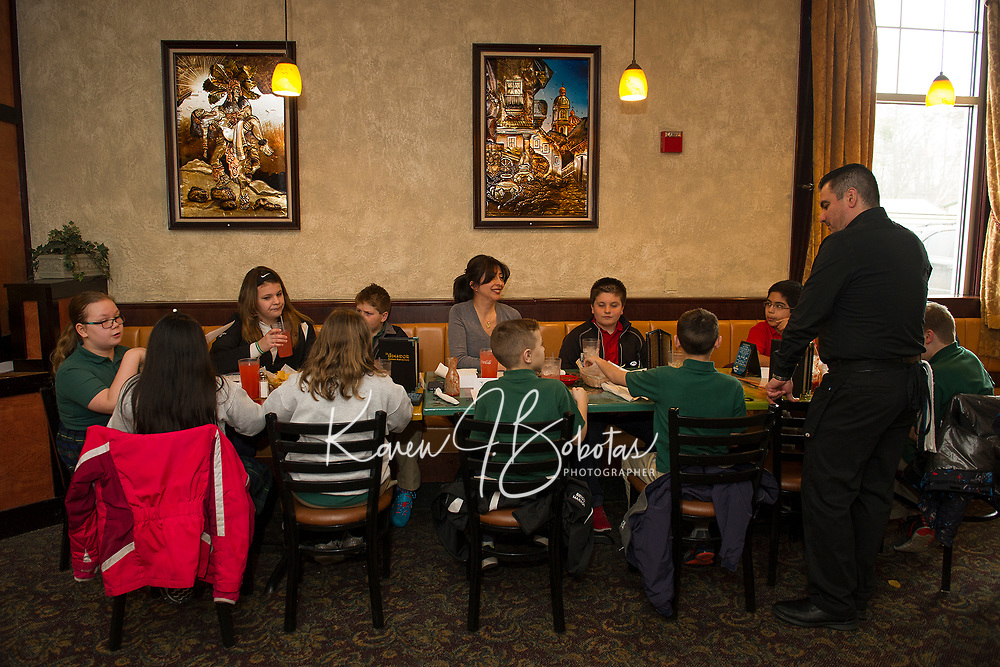 Mrs. McKinney along with her 4th and 5th graders practice their Spanish as they place their orders with waitor Antonio Leon during Holy Trinity School's field trip to Restaurante El Jimador in Belmont Thursday afternoon.  (Karen Bobotas/for the Laconia Daily Sun)