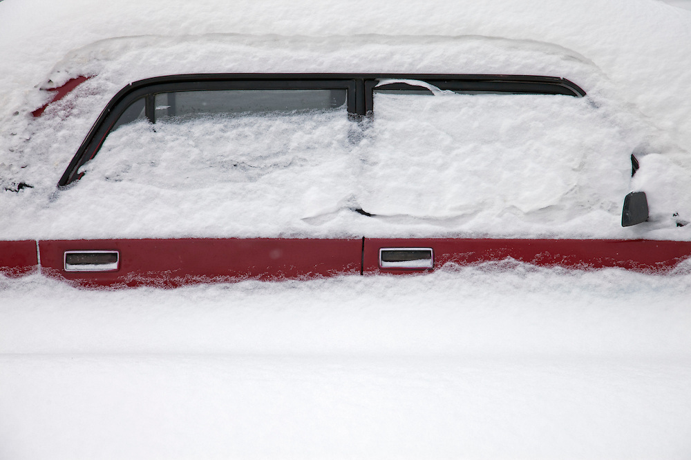 Moscow, Russia, 23/02/2010..A row of cars buried in a snowdrift in central Moscow after record amounts of snow fell over the weekend, the heaviest in the Russian capital for nearly 50 years.