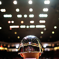 031414  Adron Gardner/Independent<br /> <br /> Lights reflect off the helmet of Seth Julian of the Dulce High School ROTC before the girls 3A championship game between the Shiprock Chieftains and the Portales Rams in Albuquerque Friday.