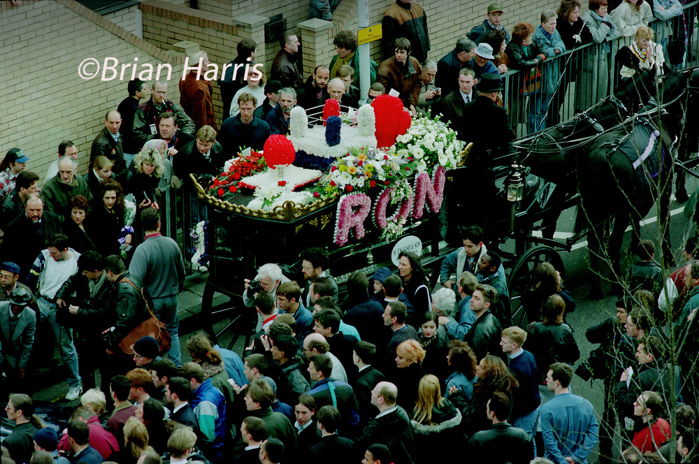 Ronnie Kray funeral Bethnal Green East London England 29 March 1995<br />Scans from 2021<br />The funeral cortege passes and pauses at site of178 Valance Road, the site of the former home of the Krays. Funeral of East End of London Gangster Ronnie Kray, twin of fellow crime boss Reggie Kray who attended the funeral as it wound its way throgh east London to the family plot in Chingford cemetery NE London.
