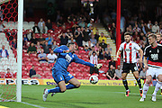 Nottingham Forest goalkeeper Stephen Henderson (30)  parrying ball allowing Brentford forward Scott Hogan (9)  to scores a goal 1-0 during the EFL Sky Bet Championship match between Brentford and Nottingham Forest at Griffin Park, London, England on 16 August 2016. Photo by Matthew Redman.